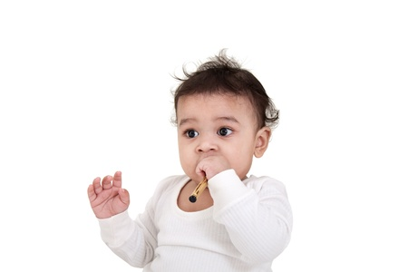 Adorable Indian baby playing with over white background Stock Photo - 12295070