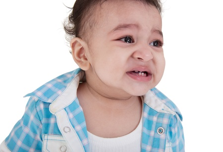 crying eyes: Adorable Indian baby crying a over white background
