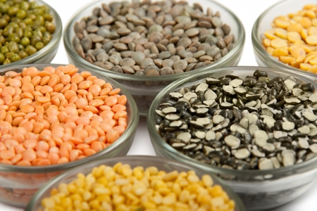 Grains pulses and beans in bowl isolated over white over Stock Photo