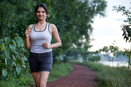 Indian girl on morning exercise or jogging in natural background