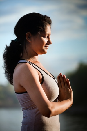 Indian girl on morning exercise or yoga in natural background Stock Photo
