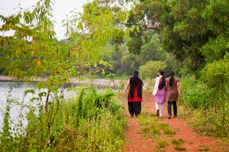 Three indian female at morning very near to lake Stock Photo - 13456706