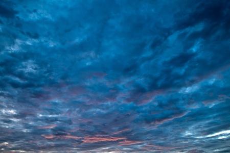 hide and seek: Hide and seek of sun with clouds in dark sky