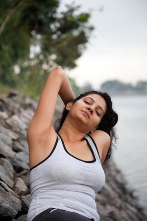 Happy indian girl on morning exercise or jogging in natural background photo