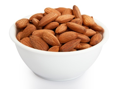 Pile of almonds in white plastic bowl isolated over white background