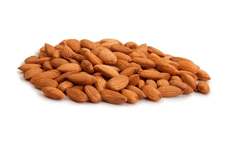 Pile of almonds isolated over white background Stock Photo