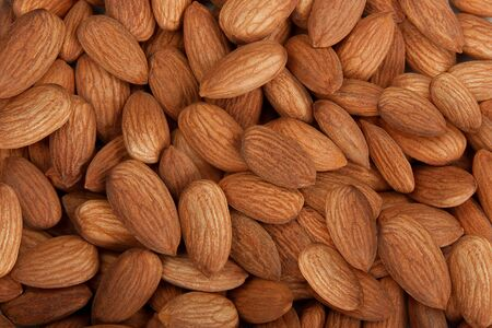 Pile of almonds isolated  Stock Photo