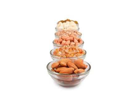 mixed fruits: Mix collection of dry fruits in glass bowl over white