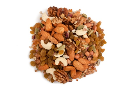 mixed nuts: Pile of mix collection of dry fruits isolated over white