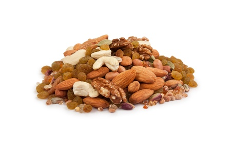 Pile of mix collection of dry fruits isolated over white photo