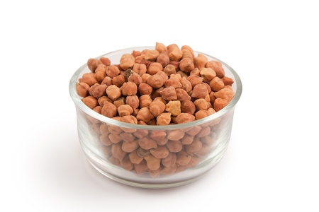 red gram: Collection of small chickpeas in transparent glass bowl