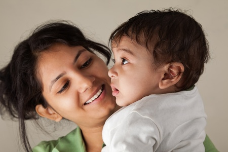 Indian Happy mother and baby playing with each other photo
