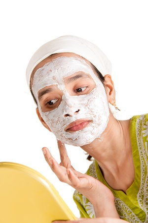 Indian woman with cosmetic mask making it her self Stock Photo