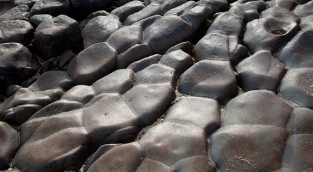 black giant: Beautiful texture of black smooth rocks and stones  , focus on stones  Stock Photo