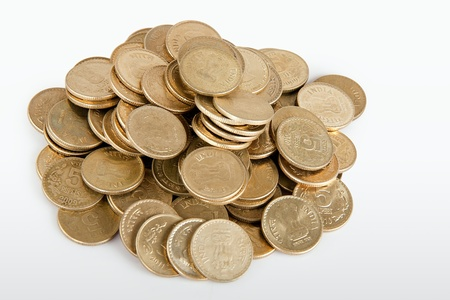 Pile of money  indian coin   isolated on white background photo
