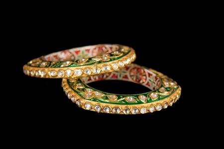 armlet: Diamond bracelet with many stones on reflective background Stock Photo