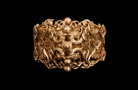 Pure Gold bracelet having itself craft of gold looking historic over black background Stock Photo - 14609181