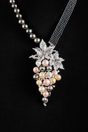 lavish: Close up of diamond necklace with Perl on black background Stock Photo