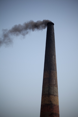Industrial pollution, dangerous toxic smoke clouds from the chimney photo