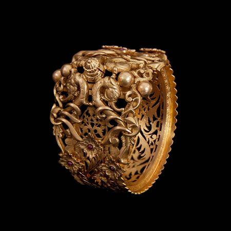 karat: Pure Gold bracelet having itself craft of gold looking historic over black background Stock Photo