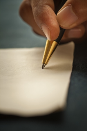 Close-up shot of a man s hand, holding a pen  photo