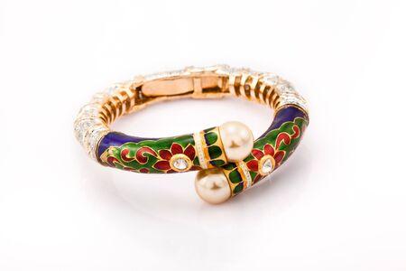 diamond stones: Diamond bracelet with many stones and pearl on white background