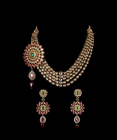 lavish: Close up of diamond necklace on black background with diamond ear ring