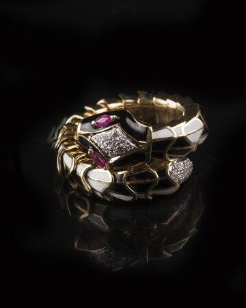 armlet: Designer diamond bracelet with many stones on reflective background