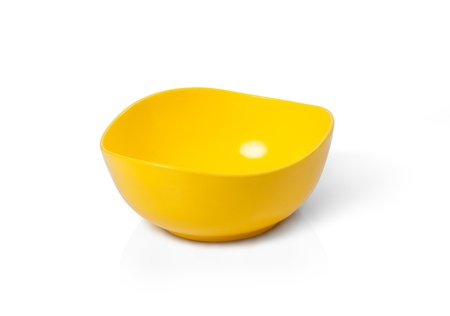 Yellow empty plastic bowl for microwave use isolated on white photo