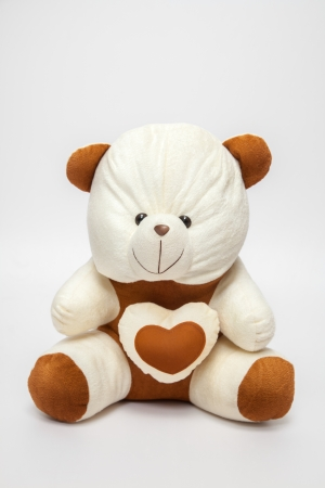 teddybear: A teddy-bear with heart, over white white,  Image may be useful for Valentines  Stock Photo