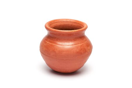 pot light: Close-up of soft clay pot over white background