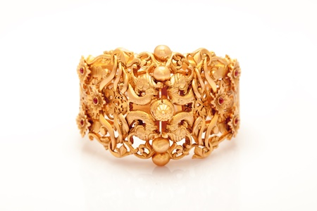 Pure Gold  bracelet  having itself craft of gold looking historic over blackwhite background Stock Photo - 16080215