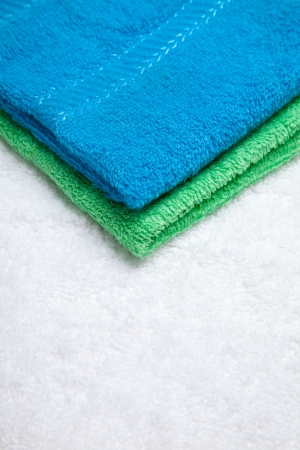 Stacked colorful towels isolates over white Stock Photo - 16928542