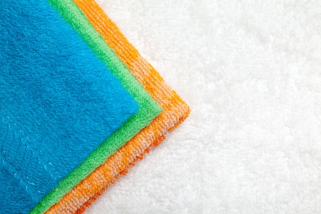 Stacked colorful towels isolates over white Stock Photo - 16931518