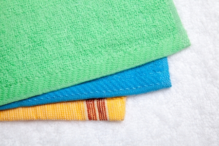 isolates: Stacked colorful towels isolates over white Stock Photo