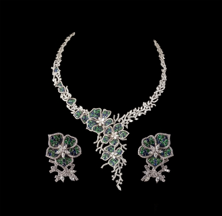 emerald stone: Close up of diamond necklace on black background with diamond ear ring