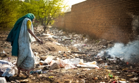 Pollution and poverty   Indian old female sitting  for warmup  herself near fire  in  garbage, Stock Photo - 18264353