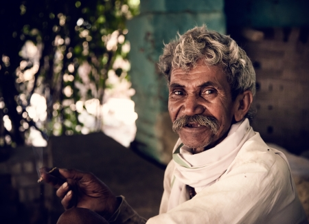 Portrait  of indian villager  while smoking with a rural cigar photo