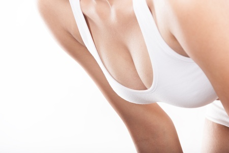 sexy boobs: Woman breast in bodice on a white background Stock Photo