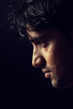 Grains   textures are added in the portrait of Indian man over dark background photo
