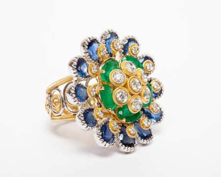 Close -up of diamond ring having many diamonds gem over white background Stock Photo - 19438747