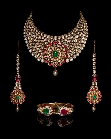 bangle: Close up of diamond necklace on black background with diamond ear ring and bracelet Stock Photo