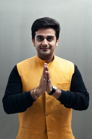 Indian young man in welcome posture