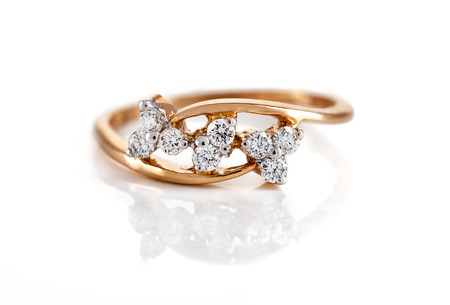 gold ring: Close up of diamond ring over white background