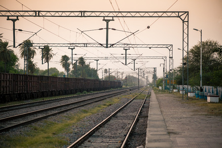 goods train: Evening at indian railway platform with goods train