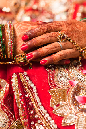 bride bangle: Hand detail of indian bride with decorative bangle and gold ring Stock Photo