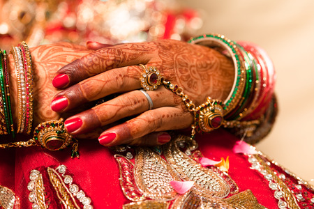 Hand detail of indian bride with decorative bangle and gold ring Stock Photo