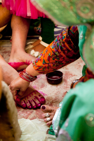 puja: Indian bride doing marriage rituals doing colored  foot fingure their mandap puja