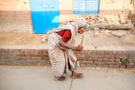 bamboo stick: Indian very old age grandma lady walking on street with the help of bamboo stick Editorial