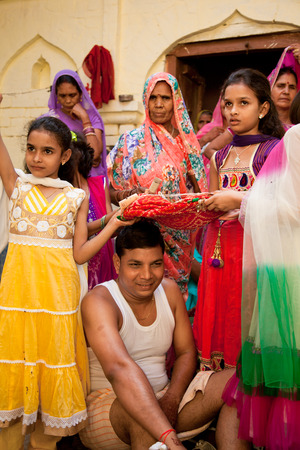 young womens: Indian groom doing marriage rituals with cross their mandap puja